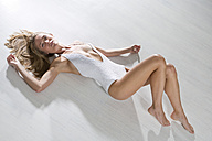 Young woman wearing white bodystocking - MAEF009195