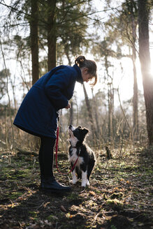 Germany, woman with Border Collie - DWF000190