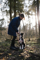 Germany, woman with Border Collie - DWF000191