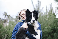 Germany, woman with Border Collie - DWF000194