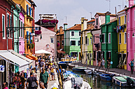 Italy, Veneto, Venice, Burano, Colourful houses and tourists by the canal - THAF000687