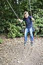 Little boy sitting on a swing - SHKF000002