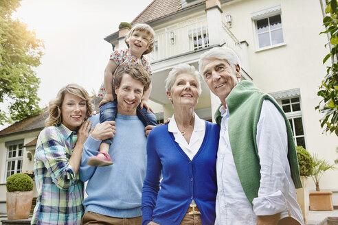 Germany, Hesse, Frankfurt, Three generations family in front of villa - RORF000076