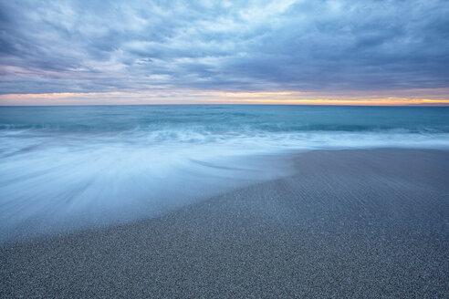 Spain, Andalusia, Natural Park of Cabo de Gata-Nijar, beach and ocean at dusk - DSGF000162