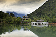 China, pagoda reflected in Black Dragon Pool in front of Jade Dragon Snow Mountain - DSGF000208
