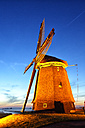 Netherlands, North Holland, windmill at dusk - DSGF000785
