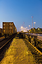 Germany, Hamburg, railway yard, freight train in the evening light - MS004287