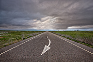 Spain, Province of Zamora, country road under cloudy sky - DSGF000811