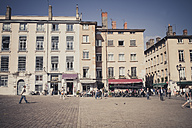 France, Department Rhone, Lyon, Historic town centre, row of houses and sidewalk cafes - SBDF001325