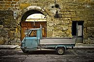 Italy, Apulia, Leccei, parking Piaggio Ape in front of house facade - DIKF000120