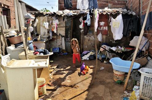Brazil, Ceilandia near Brasilia, girl in a favela - FLK000486