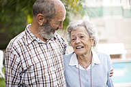 Happy senior couple in a retirement village - ZEF001291
