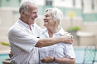 Happy senior couple in a retirement village - ZEF001292