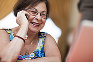 Smiling senior woman on cell phone - ZEF001323