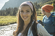 Austria, Tyrol, Tannheimer Tal, portrait of happy young female hiker - UUF002124