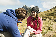 Austria, Tyrol, Tannheimer Tal, young man caring for injured woman on hiking tour - UUF002246
