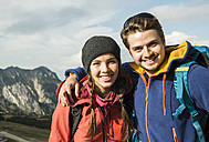Austria, Tyrol, Tannheimer Tal, portrait of smiling young couple - UUF002213