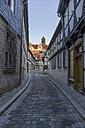 Germany, Saxony-Anhalt, Quedlinburg, Alleyway and St. Servatius church - PVCF000138