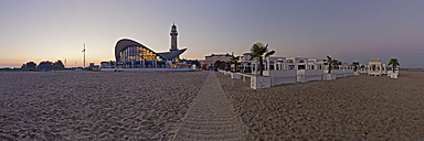 Germany, Mecklenburg-Western Pomerania, Warnemuende, Old lighthouse, Teepott and beach bar in the morning light, Panorama - MELF000023