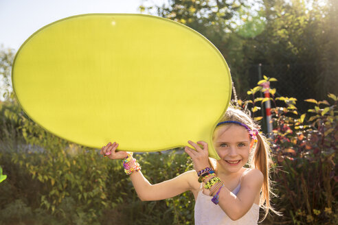 Portrait of smiling girl holding yellow speech balloon - SARF000914