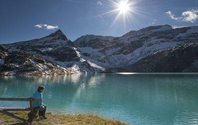 Austria, Salzburg State, Pinzgau, woman at Weisssee mountain lake - MKFF000130