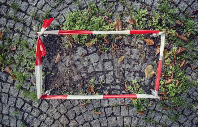Germany, fixed barrier tape arround damaged cobblestone pavement - OPF000011