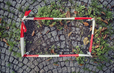 Germany, fixed barrier tape arround damaged cobblestone pavement - OPF000011