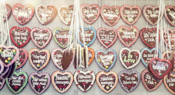 Germany, Bavaria, Munich, rows of gingerbread hearts at Oktoberfest - OPF000016
