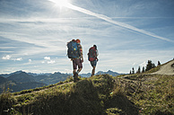 Austria, Tyrol, Tannheimer Tal, young couple hiking on mountain trail - UUF002205