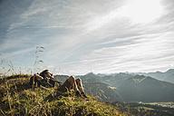 Austria, Tyrol, Tannheimer Tal, young hiker having a rest - UUF002185