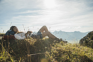 Austria, Tyrol, Tannheimer Tal, young hiker having a rest - UUF002177