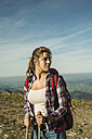 Austria, Tyrol, Tannheimer Tal, young woman on a hiking trip - UUF002162