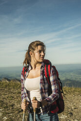 Austria, Tyrol, Tannheimer Tal, young woman on a hiking trip - UUF002162