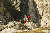Austria, Tyrol, Tannheimer Tal, young couple standing at rocks - UUF002154