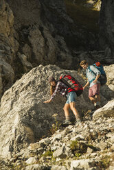 Austria, Tyrol, Tannheimer Tal, young couple hiking at rocks - UUF002151