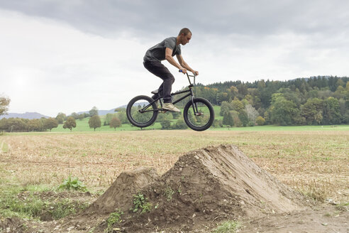 Germany, Freiburg, Young man jumping with BMX bike - DRF001135