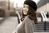 Portrait of smiling young woman wearing beret and knitted dress - GDF000500