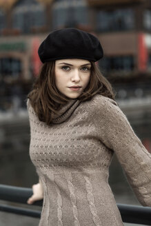 Portrait of young woman wearing beret and knitted dress - GDF000496