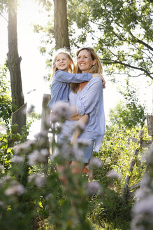 Mother and her little daughter enjoying country life - FKIF000036