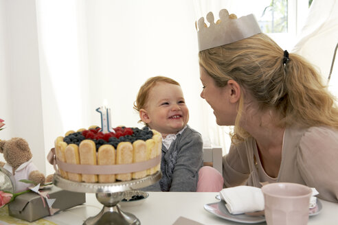 Mother and daughter celebrating little girl's first birthday with self-made fancy cake - FSF000229