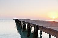Spain, Balearic Islands, Cala de Muro, one man walking on a jetty - MSF004317