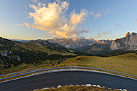 Italy, South Tyrol, Dolomites, View from Sella pass road at sunset - RJF000332