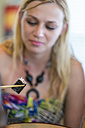 Young woman eating sushi with chop sticks - ABAF001535