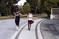 Stylish young holding hands - DAW000181
