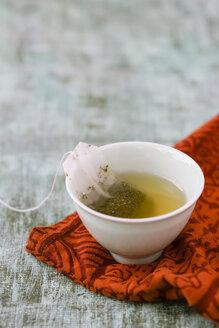 Bowl of Ceylon tea with tea bag on cloth - MYF000633