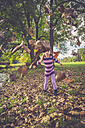 Little girl throwing autumn leaves - SARF000932