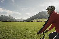 Austria, Tyrol, Tannheimer Tal, man driving mountainbike - UUF002321