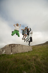 United Kingdom, England, Cornwall, Children jumping from stone - PAF001022