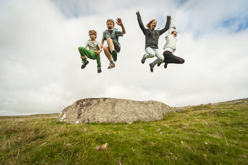 United Kingdom, England, Cornwall, Children jumping from stone - PAF001025
