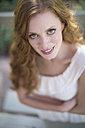 Portrait of smiling young woman outdoors - ZEF007951